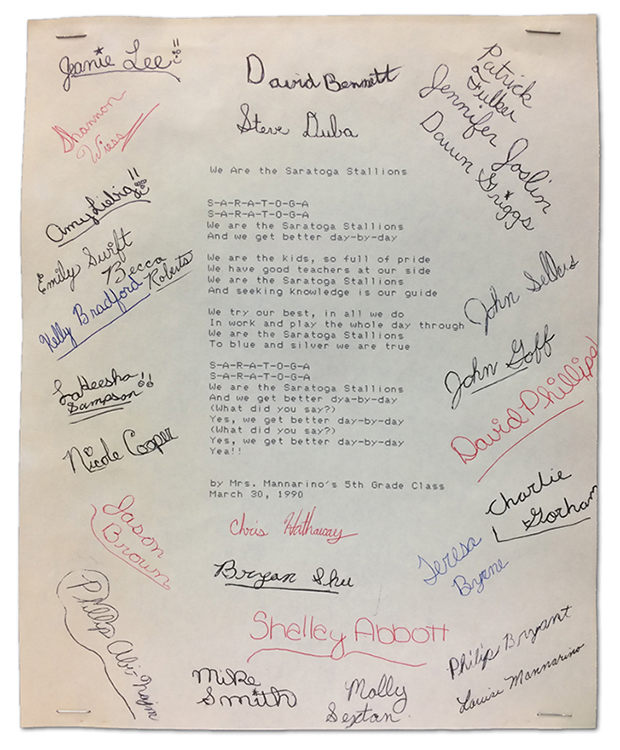 Photograph of the piece of paper on which the original school song was printed. The paper is signed by all the students in Mrs. Mannarino's class who helped to write the song.